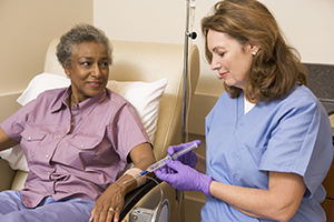 patient receiving IV chemotherapy from nurse