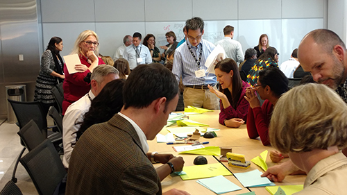 QTP participants in a room at ASCO headquarters, working on their projects