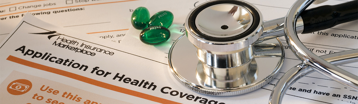 Medical paperwork, pills, and stethoscope