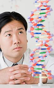 Man looking at double helix